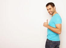 Happy young man showing thumbs up Royalty Free Stock Photography