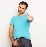 Happy young man showing thumbs up Stock Photo