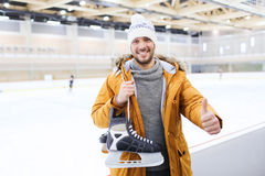 Happy young man showing thumbs up on skating rink Stock Images