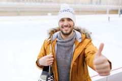 Happy young man showing thumbs up on skating rink Stock Image