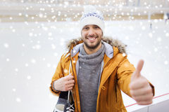 Happy young man showing thumbs up on skating rink Royalty Free Stock Images