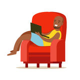 Happy young man sitting in a red armchair and using laptop, colorful character vector Illustration Royalty Free Stock Image