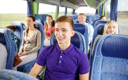 Happy young man sitting in travel bus or train Stock Image