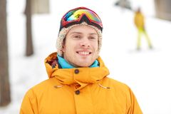 Happy young man in ski goggles outdoors Royalty Free Stock Photo
