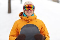 Happy young man in ski goggles outdoors Stock Images