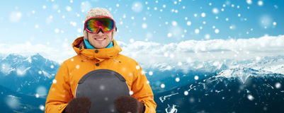 Happy young man in ski goggles over mountains Royalty Free Stock Photography