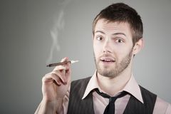 Happy young man with small cigar Stock Image