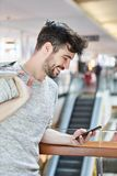 Happy young man with smartphone royalty free stock image