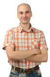 Happy young man smiling with arms crossed Stock Photos