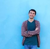 Happy young man smiling with arms crossed Stock Photo