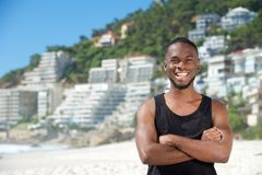 Happy young man smiling at the beach Royalty Free Stock Photo