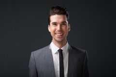 Happy young man smiling in business suit Royalty Free Stock Photos