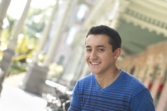 Happy young man smiling. Young man smiling at camera, outdoors Royalty Free Stock Photography