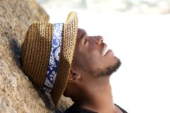 Happy young man smiling with hat Royalty Free Stock Images