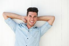 Happy young man smiling outdoors Stock Photos