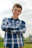 Happy young man smiling outdoors. On spring or summer day stock images