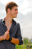 Happy young man smiling outdoors Stock Photography