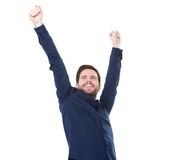 Happy young man smiling with raised arms Stock Photos