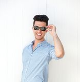 Happy young man smiling with sunglasses Stock Image