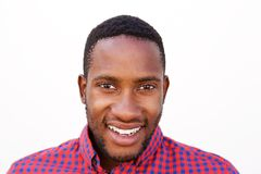 Happy young man smiling on white background. Close up portrait of happy young man smiling on white background Royalty Free Stock Photo