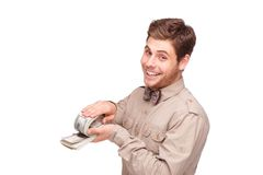 Happy young man with soft money Royalty Free Stock Photography