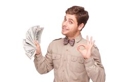 Happy young man with soft money Royalty Free Stock Photo