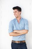 Happy young man standing against white wall outdoors Royalty Free Stock Images