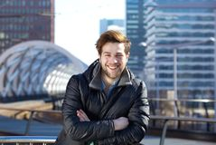 Happy young man standing downtown city Stock Photo