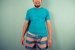 Happy young man in striped shorts stock photos