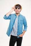 Happy young man in sunglasses standing and smiling Stock Photography