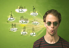 Happy young man with sunglasses traveling to cities around the w Royalty Free Stock Photo