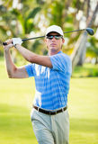 Happy young  man swinging golf club Royalty Free Stock Images
