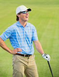 Happy young  man swinging golf club Stock Photography