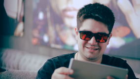 Happy young man with tablet computer in cafe. stock footage
