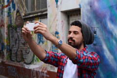 Happy young man taking a selfie. Royalty Free Stock Photography