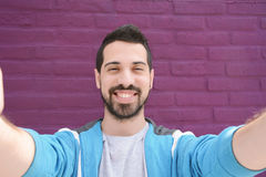 Happy young man taking a selfie. Royalty Free Stock Photo