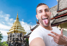 Happy young man taking a selfie photo in Bangkok, Thailand Stock Photography