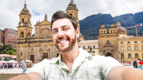 Happy young man taking a selfie photo in Bogota, Colombia Stock Images