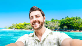 Happy young man taking a selfie photo in Cairns, Australia Stock Photo