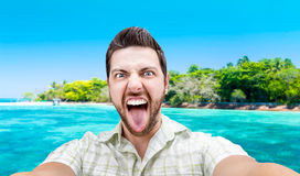 Happy young man taking a selfie photo in Cairns, Australia Royalty Free Stock Images
