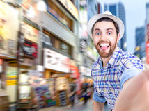 Happy young man taking a selfie photo in the city Royalty Free Stock Photos