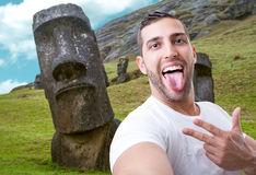 Happy young man taking a selfie photo in Easter Island, Chile Royalty Free Stock Photo
