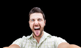 Happy young man taking a selfie photo isolated on black background Royalty Free Stock Photo