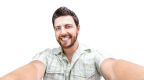Happy young man taking a selfie photo isolated on white background Royalty Free Stock Images