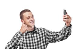 Happy young man taking a selfie Royalty Free Stock Images