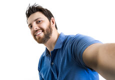 Happy young man taking a selfie photo isolated on white background Stock Images