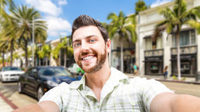 Happy young man taking a selfie photo in Los Angeles, USA Royalty Free Stock Image