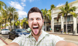 Happy young man taking a selfie photo in Los Angeles, USA Stock Photos