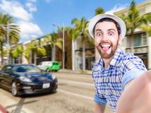Happy young man taking a selfie photo in Los Angeles, USA Stock Image