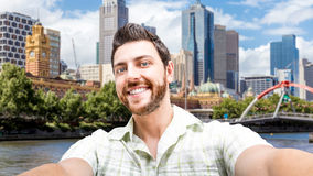 Happy young man taking a selfie photo in Melbourne, Australia Stock Photos